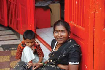 Dalit woman and son outside a shop in Pune
