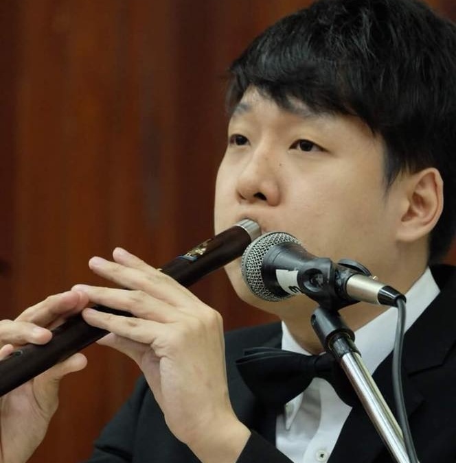 A young Thai musician who plays a traditional Thai instrument